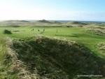 Golfeurs sur le green sur le parcours de Machrihanish